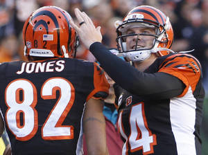 Photo - Cincinnati Bengals quarterback Andy Dalton (14) congratulates wide receiver Marvin Jones (82) after they combined on their third touchdown pass of the game in the first half of an NFL football game against the New York Jets, Sunday, Oct. 27, 2013, in Cincinnati. (AP Photo/David Kohl)