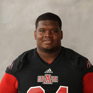 Photo - This 2013 photo released by the Arkansas State shows NCAA college football player Markel Owens. Authorities said Thursday, Jan. 16, 214, that the junior defensive lineman was one of two men shot to death during a home invasion robbery in Jackson, Tenn., Wednesday night. (AP Photo/Arkansas State, Richard Bishop)