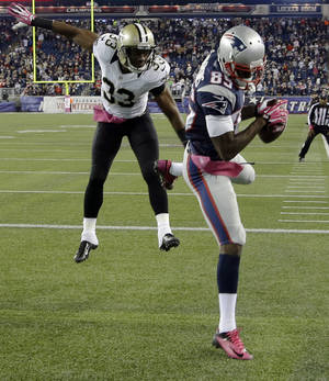 Photo - New England Patriots wide receiver Kenbrell Thompkins (85) comes down in the end zone with the winning touchdown catch against New Orleans Saints cornerback Jabari Greer (33) in the fourth quarter of an NFL football game Sunday, Oct.13, 2013, in Foxborough, Mass. The Patriots won 30-27. (AP Photo/Stephan Savoia)