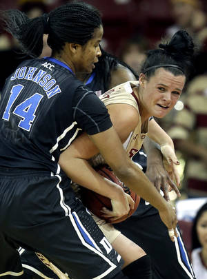 photo - Duke guard Ka'lia Johnson (14) grabs for control of the ball with Boston College guard Kristen Doherty, right, during the first half of an NCAA women's college basketball game at Boston College, Sunday, Jan. 6, 2013, in Boston. (AP Photo/Steven Senne)