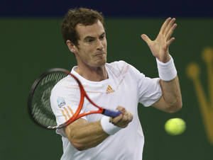 Photo -   Andy Murray of Britain returns a shot to Roger Federer of Switzerland during the men's singles semifinal match at the Shanghai Masters tennis tournament at Qizhong Forest Sports City Tennis Center in Shanghai, China, Saturday Oct. 13, 2012. (AP Photo/Kin Cheung)