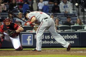 Photo - Washington Nationals left fielder Bryce Harper (34) is hit by a pit by Atlanta Braves' Luis Avilan during the eighth inning of a baseball game in Atlanta, Friday, Aug. 16, 2013. (AP Photo/John Amis)