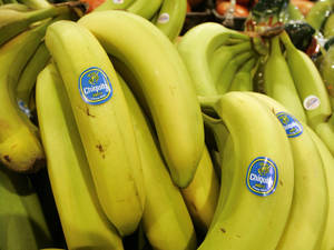 Photo - FILE - Chiquita bananas are on display at a grocery store in Bainbridge, Ohio in this Aug. 3, 2005 file photo. Faced with potentially billions of dollars in legal liability, Chiquita Brands International is asking a federal appeals court to block lawsuits filed against it in the U.S. by thousands of Colombians whose relatives were killed in that country's bloody, decades-long civil war. The produce giant, which long had huge banana plantations in Colombia, has admitted paying a right-wing Colombian paramilitary group $1.7 million over a seven-year period. (AP Photo/Amy Sancetta, File)