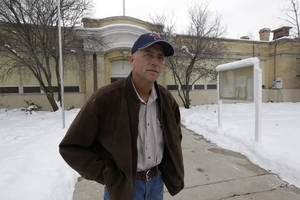 photo - Spring City Councilman Neil Sorensen stands in front of the City Hall Tuesday, Jan. 8, 2013, in Spring City, Utah. Officials in a small Utah town are urging citizens and teachers to arm themselves for everyone's safety against any aggressor. One member of the Spring City council wants to make the edict mandatory, but police are urging restraint. Councilman Neil Sorensen says he's drafting a measure that will go before the full council in February. At first, Sorensen wanted to mandate a gun in every household in the town of 1,000. But the Sanpete County sheriff didn't think it was a good idea to force households to own guns, so Sorensen says he's inclined to make it a recommendation, not a law. (AP Photo/Rick Bowmer)