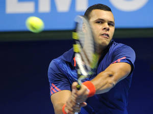 Photo -   France's Jo-Wilfried Tsonga returns a backhand to Japan's Go Soeda in the 2nd round match in the Stockholm Open tennis tournament in the Royal Tennis Hall in Stockholm, Sweden, Thursday Oct. 18, 2012. (AP Photo / Anders Wiklund / SCANPIX) SWEDEN OUT