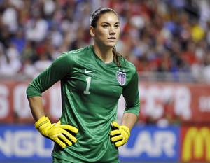 Photo - FILE - In this Oct. 20, 2013, file photo, United States goalkeeper Hope Solo pauses on the field during the second half of an international friendly women's soccer match against Australia in San Antonio. Police say Solo has been arrested early Saturday, June 21, 2014, at a suburban Seattle home for assaulting her sister and nephew. (AP Photo/Darren Abate, File)