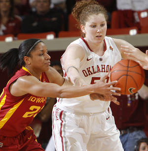 photo - Oklahoma's Joanna McFarland (53) battles for a loose ball with Iowa State's Chassidy Cole (230 during the women's college basketball game between the University of Oklahoma Sooners (OU) and the Iowa State University Cyclones (ISU) at the Lloyd Noble Center on Wednesday, Jan. 4, 2012, in Norman, Okla.  Photo by Chris Landsberger, The Oklahoman