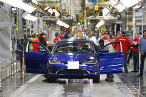 Photo - In this March 14, 2014 photo, a 2015 Chrysler 200 automobile moves down the assembly line at the Sterling Heights Assembly Plant in Sterling Heights, Mich. Automakers report sales for May on Tuesday, June 3, 2014. (AP Photo/Paul Sancya)