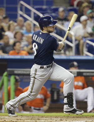 Photo - Milwaukee Brewers' Ryan Braun follows through on a single in the fourth inning during a baseball game against the Miami Marlins, Sunday, May 25, 2014, in Miami. The Brewers defeated the Marlins 7-1. (AP Photo/Lynne Sladky)