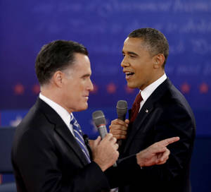 Photo - FILE - In this Oct. 18, 2012 file photo, President Barack Obama, right, and Republican presidential candidate, former Massachusetts Gov. Mitt Romney exchange views during the second presidential debate at Hofstra University in Hempstead, N.Y. The binders are long gone, but Mitt Romney's awkward phrase is likely to endure at least a little longer.  The GOP nominee was trying to convey his commitment to hiring women when he spoke during one of the debates about demanding more potential job applicants when he was Massachusetts governor. (AP Photo/David Goldman, File) ORG XMIT: WX112