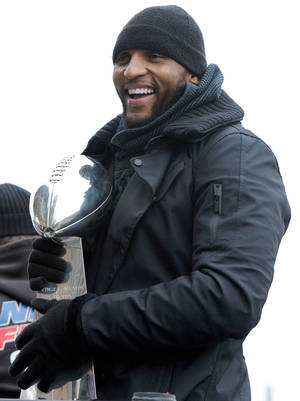 Photo - Baltimore Ravens linebacker Ray Lewis holds the Vince Lombardi trophy during a parade and celebration of the team's Super Bowl championship in Baltimore Tuesday, Feb. 5, 2013. The Ravens defeated the San Francisco 49ers 34-31 in Super Bowl XLVII on Sunday. (AP Photo/Steve Ruark)