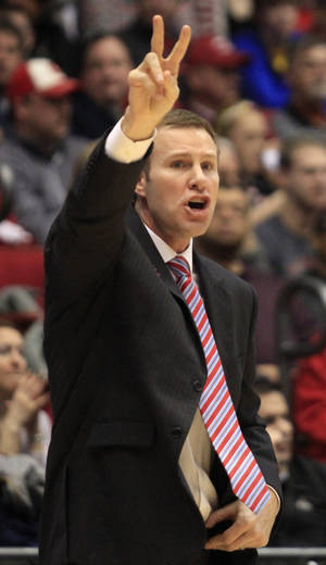 Photo - Iowa State head coach Fred Hoiberg calls a play against Ohio State in the first half of a third-round game of the NCAA college basketball tournament  Sunday March 24, 2013, in Dayton, Ohio. (AP Photo/Skip Peterson)