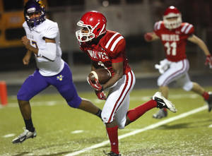 photo - Davis senior runningback Michael Nowden outraces Vian defender Shawn Troutman  as he makes his way into the end zone, scoring his team's second touchdown in the first half.  Vian Wolverines play Davis Wolves in the Class 2A semifinal game Friday night, Friday, Nov. 30, 2012, at Rose Field, Jim Darnell Stadium in Midwest City.  Photo by Jim Beckel, The Oklahoman