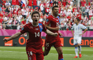 photo -   Czech Republic's Vaclav Pilar, left, and Milan Baros celebrate after their team scored second goal during the Euro 2012 soccer championship Group A match between Greece and Czech Republic in Wroclaw, Poland, Tuesday, June 12, 2012. (AP Photo/Thanassis Stavrakis)