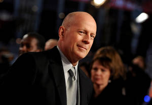 Photo - In this picture made available Tuesday Feb. 5, 2013,  US actor Bruce Willis , arrives  for the premiere of the movie  'A Good Day to Die Hard' in Berlin, Germany, Monday Feb. 4, 2013.   (AP Photo/dpa, Britta Pedersen)