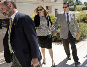 Photo - Melanie and Matt Capobianco arrive at the Oklahoma Supreme Court for a custody hearing Sept. 3 Photo by Chris Landsberger, The Oklahoman