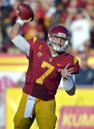 Photo -   FILE - In this Sept. 1, 2012, file photo, Southern California quarterback Matt Barkley passes during the first half of an NCAA college football game against Hawaii in Los Angeles. The last time Barkley and Josh Nunes played against each other was at the 2009 High School All-American Game. Things will be a little different for these quarterbacks Saturday night when Barkley and No. 2 Southern California face Nunes and No. 21 Stanford. (AP Photo/Mark J. Terrill, File)