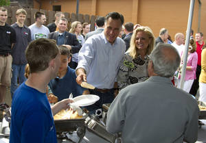 photo -   Republican presidential candidate, former Massachusetts Gov. Mitt Romney, left, serves pancakes with his wife Ann, during a campaign stop at Mapleside Farms Sunday, June 17, 2012, in Brunswick, Ohio. (AP Photo/Evan Vucci)
