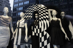 photo -   Mannequins are fashionably dressed in a Bloomingdale's store window, Thursday, Oct. 13, 2011 in New York. U.S. consumers stepped up their spending on retail goods in September, a hopeful sign for the sluggish economy. (AP Photo/Mark Lennihan)