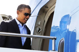 Photo - President Barack Obama boards Air Force One to leave Palm Springs International Airport in Palm Springs, Calif., on Monday, Feb. 17, 2014, en route to return to Washington. (AP Photo/Jacquelyn Martin)