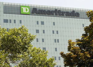 Photo - FILE - In this Monday, July 16, 2012, file photo, TD Ameritrade's new corporate headquarters stands in Omaha, Neb. A surge in trading activity at the end of 2013 helped online brokerage TD Ameritrade record a 31 percent jump in its quarterly profit as the economy continued improving and Congress avoided another budget stalemate. (AP Photo/Nati Harnik, File)