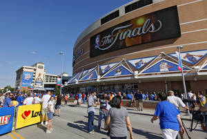 Photo - Fans arrive in Thunder Alley before Game 1 of the NBA Finals on Tuesday in Oklahoma City.  Photo by Chris Landsberger, The Oklahoman