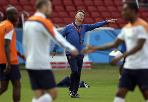 Photo - Netherlands' head coach Louis van Gaal points during the official training the day before the group B World Cup soccer match between Australia and the Netherlands at the Estadio Beira-Rio in Porto Alegre, Brazil, Tuesday, June 17, 2014. (AP Photo/Michael Sohn)