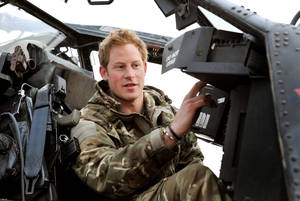 "Photo - FILE - In this Dec. 12, 2012, file photo Britain's Prince Harry makes his early morning pre-flight checks on the flight-line, from Camp Bastion southern Afghanistan. Palace officials say that Prince Harry is ending his role as a helicopter pilot and taking up a new job with the army in London. Kensington Palace said Harry — known in the army as Capt. Wales — will now be organizing ""major commemorative events"" involving the army. (AP Photo/ John Stillwell, Pool)"