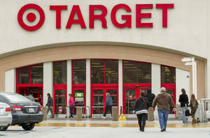 Photo - FILE -- In this Dec. 19, 2013 file photo, shoppers arrive at a Target store in Los Angeles on Thursday, Dec. 19, 2013. Target reports quarterly financial results on Wednesday, May 21, 2014. (AP Photo/Damian Dovarganes, File)