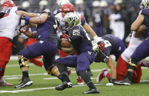 Photo - Washington's Bishop Sankey (25) runs the ball during the first half of an NCAA college football game against Arizona, Saturday, Sept. 28, 2013, in Seattle. (AP Photo/Ted S. Warren)