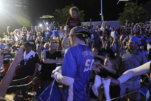 Photo - About 5,000 fans gathered April 30 in Thunder Alley during Game 2 against the Dallas Mavericks in the first round of the NBA Playoffs. On Monday, a shooting a few blocks away from the Chesapeake Energy Arena left at least eight people injured. Archive photo by Garett Fisbeck, For The Oklahoman