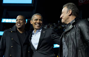 Photo -   President Barack Obama is flanked on stage by musicians Jay-Z, left, and Bruce Springsteen at a campaign event at Nationwide Arena, Monday, Nov. 5, 2012, in Columbus, Ohio. (AP Photo/Carolyn Kaster)