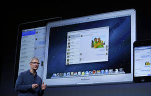 Photo -   Apple CEO Tim Cook speaks during an event to announce new products in San Jose, Calif., Tuesday, Oct. 23, 2012. (AP Photo/Marcio Jose Sanchez)