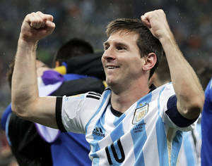 Photo - Argentina's Lionel Messi pumps his fists after Argentina defeated the Netherlands 4-2 in a penalty shootout after a 0-0 tie after extra time to advance to the finals after the World Cup semifinal soccer match between the Netherlands and Argentina at the Itaquerao Stadium in Sao Paulo Brazil, Wednesday, July 9, 2014. (AP Photo/Victor R. Caivano)