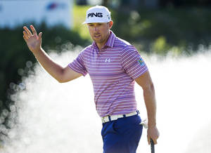 Photo - Hunter Mahan of the United States waves after sinking a birdie putt on the 18th hole during the second round at the Canadian Open golf tournament at Glen Abbey in Oakville, Ontario, on Friday, July 26, 2013. (AP Photo/The Canadian Press, Nathan Denette)