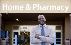 "Photo - This photo taken Nov. 21, 2013 shows James Lott outside the Wal-Mart store where he works as a pharmacist in Bonney Lake, Wash. Lott, who lives in Renton, Wash., a suburb of Seattle, adds significantly to his six-figure job salary by day-trading stocks. It's not just the wealthiest 1 percent: Fully 20 percent of U.S. adults become rich for parts of their lives, wielding outsized influence on America's economy and politics. And this little-known group may pose the biggest barrier to reducing the nation's income inequality. While the growing numbers of the U.S. poor have been well documented, survey data provided exclusively to The Associated Press detail the flip side of the record income gap: the rise of the ""new rich."" (AP Photo/Elaine Thompson)"