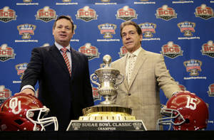 Photo - Alabama head coach Nick Saban, right, and Oklahoma head coach Bob Stoops pose with the Sugar Bowl trophy during an NCAA college football news conference in New Orleans, Wednesday, Jan. 1, 2014. Oklahoma takes on Alabama in the Sugar Bowl on Thursday. (AP Photo/Gerald Herbert)
