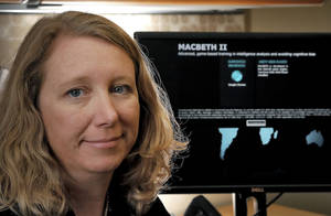 Photo - University of Oklahoma researcher Dr. Norah Dunbar poses for a photo with the computer game called Macbeth at her office. Dunbar and her team have developed this game that helps intelligence teams learn to take cognitive biases out of their decision making. <strong>CHRIS LANDSBERGER</strong>