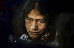 In this Wednesday, Aug. 20, 2014 photo,  Irom Sharmila speaks to the media outside a security ward after her release in Porompal district, in Imphal, India. India's most famous prisoner of conscience walked free after nearly 14 years in jail but vowed to continue the hunger strike that landed her in prison for attempted suicide.  Sharmila, 42, has not eaten a single morsel of food voluntarily since November 2000, when she began her protest against an Indian law that suspends many human rights protections in areas of conflict. (AP Photo/Bullu Raj)