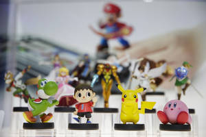 Photo -  Amiibo characters for Wii U are on display at the Nintendo booth during the Electronic Entertainment Expo on Tuesday in Los Angeles. AP Photo)  <strong>Jae C. Hong -  AP </strong>