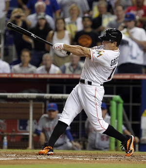 Photo -   Miami Marlins' Adam Greensberg swings at the third strike against the New York Mets during the sixth inning of a baseball game in Miami, Tuesday, Oct. 2, 2012. (AP Photo/Alan Diaz)