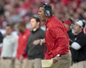 Photo -   Ohio State coach Urban Meyer directs his team from the sidelines during the first half of a college football game against Wisconsin Saturday, Nov. 17, 2012, in Madison, Wis. Ohio State won 21-14 in overtime. (AP Photo/Andy Manis)