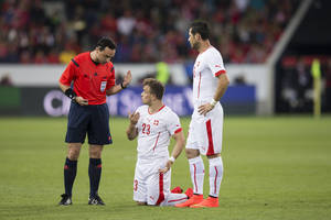 Photo - Switzerland's Xherdan Shaqiri, center, and Switzerland's Blerim Dzemaili, right, talk to the referee Neil Doyle of Ireland during the international friendly soccer match between Switzerland and Jamaica at the Swissporarena in Lucerne, Switzerland, Friday, May 30, 2014. Switzerland are preparing for the upcoming FIFA soccer World Cup in Brazil starting on 12 June. (AP Photo/Keystone, Peter Klaunzer)