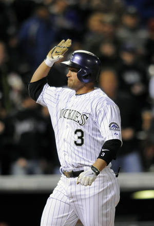 Photo - Colorado Rockies Michael Cuddyer celebrates a two-run home run in the fourth inning of a baseball game against the Arizona Diamondbacks on Saturday, April 5, 2014, in Denver. (AP Photo/Chris Schneider)
