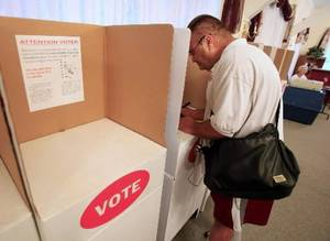 photo - Gene Lemons, Okla. City, in the voting booth at precinct 460, 3106 N. Utah, in northwest Oklahoma City Tuesday, July 27, 2010. Photo by Paul B. Southerland
