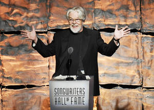 photo - Inductee Bob Seger speaks at the 2012 Songwriters Hall of Fame induction and awards gala Thursday at the Marriott Marquis Hotel in New York.  Photo by Evan Agostini/Invision