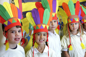 photo - First-graders Brogan Holt, Alya Bakir, Issac Johnson and Lakein Ruble wear colorful headdresses for the Thanksgiving pageant at St. Mary's Episcopal School. PHOTOS BY DAVID MCDANIEL, THE OKLAHOMAN