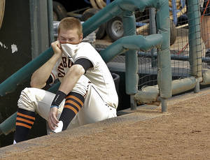 photo - OSU / BIG 12 TOURNAMENT / COLLEGE BASEBALL: Oklahoma State's Mark Ginther (9) covers his face as he sits in the dugout in the Cowboy's 11-5 loss to Kansas State during the Big 12 baseball tournament game between Oklahoma State University  and Kansas State University at the Chickasaw Bricktown Ballparkon Thursday, May 24, 2012, in Oklahoma City, Oklahoma. Photo by Chris Landsberger, The Oklahoman