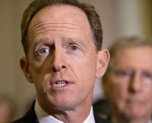 Photo - FILE - In this July 30, 2013 file photo, Sen. Pat Toomey, R-Pa. speaks with reporters on Capitol Hill in Washington. Flood insurance rate increases for hundreds of thousands of people would be put off under a bill that's steaming toward passage in the Senate, powered by coastal lawmakers telling horror stories of constituents at risk of losing their homes with the implementation of an overhaul of the federal flood insurance program passed less than two years ago. The Senate measure to delay some of the changes is likely to pass after votes on a host of amendments, including a plan by Toomey to phase in rate increases more slowly. It was unclear whether the measure will pass on Wednesday or Thursday.  (AP Photo/J. Scott Applewhite, File)