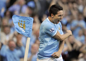 Photo - Manchester City's Samir Nasri celebrates after he scores the fourth goal of the game for his side during their English Premier League soccer match against Manchester United at the Etihad Stadium in Manchester, England, Sunday Sept 22, 2013. (AP Photo/Clint Hughes)